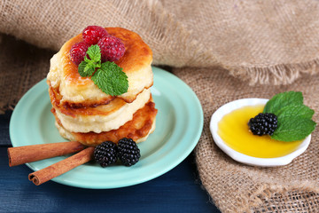 Tasty pancake with fresh berries and mint leaf