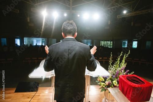 Pastor praying for congregation - 71384131