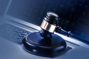 Gavel on computer legal law background