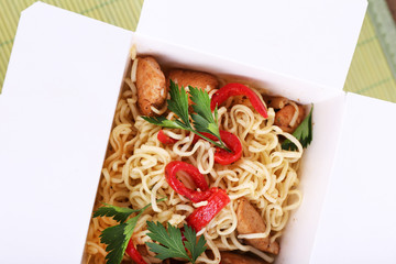Chinese noodles in takeaway box closeup