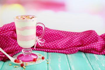 Cranberry milk dessert in glass