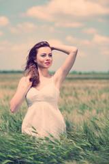 Beautiful young woman in field