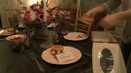 Restaurant worker puts desserts on plates