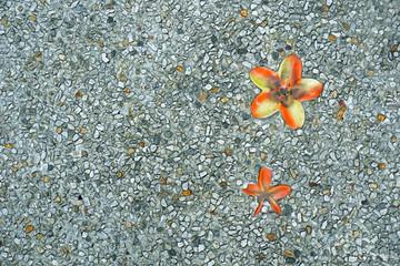 stone floor, with ceramic flower.