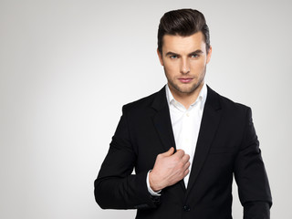 Fashion young businessman in black suit