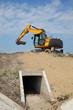 Leinwanddruck Bild - Agriculture, irrigation channel construction site in field