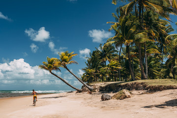 Cycling on Taipu de Fora beach, Marau, Bahia, Brazil.