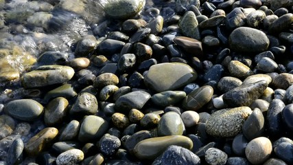 sea ​​wave rolls on the shore of pebbles