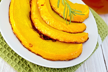 Pumpkin baked with honey in bowl on napkin