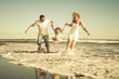 Happy family playing on the beach at the day time - 71392338