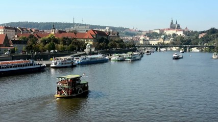 boats on the river (Vltava) - city (buildings) - Prague Castle