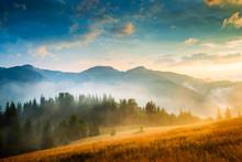 "Постер, картина, фотообои ""Amazing mountain landscape with fog and a haystack"""