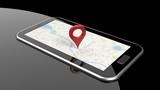 Fototapety Tablet with map on screen and red pin isolated
