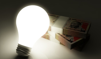 Lightbulb with money stack
