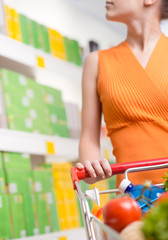 Woman choosing products at supermarket