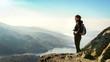 hiker on top of the mountain enjoying view, Ben A'an, Scotland