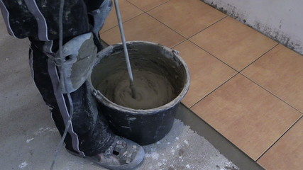 Mixing tile adhesive or cement with power drill tool