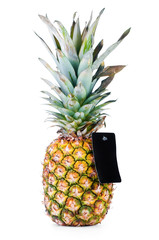 Ripe pineapple with empty price tag isolated on white background