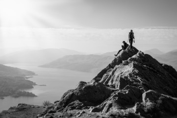 hikers on top of the mountain enjoying view, Highlands, Scotland