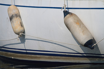 Two fenders on the sides of the boat close up