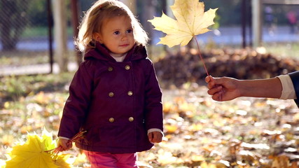 Family walk in the nature in autumn.