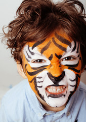 little cute boy with faceart on birthday party close up, little