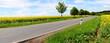 Leinwanddruck Bild - Landstrasse mit Bäumen