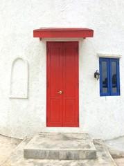 red wood door in the wall