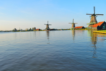 Dutch windmills in the summer and a lake