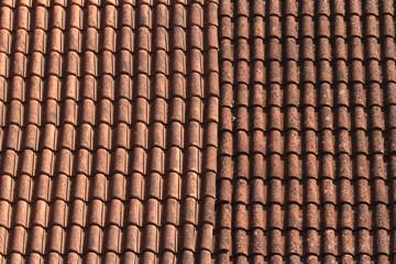Old ceramic tile roof close up. background