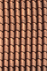 Old terracotta tile roof close up. background vertical