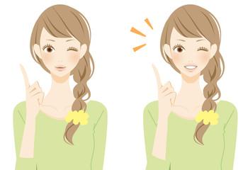 ポイントを表現する笑顔の女性
