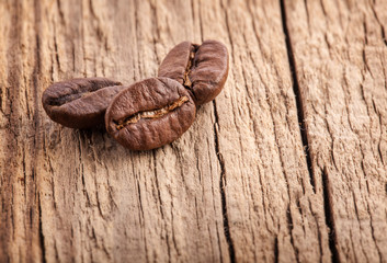 Coffee grains on old wooden board