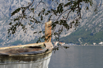 old boat closeup on a background of the bay and mountains.
