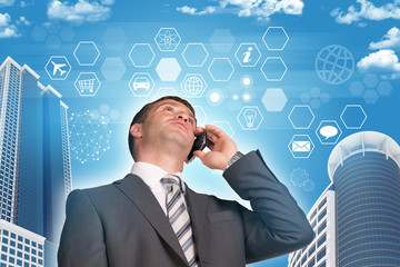 Businessman talking on the phone. Skyscrapers and hexagons with