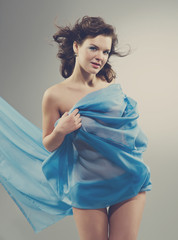 Beautiful woman in  waving fabric.
