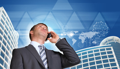 Businessman talking on the phone. Skyscrapers, sky and triangles