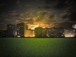 Buildings and green grass field