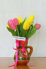 Congratulations card with pink and yellow tulips