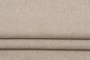 Folded Natural Linen Textile. Background With Copy Space