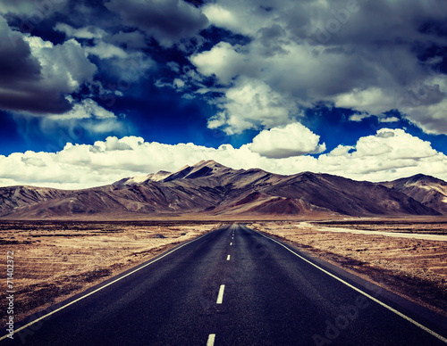Road on plains in Himalayas with mountains - 71402372