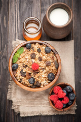 Homemade granola, honey and berries