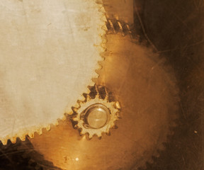 Old rusty gears through scratched glass