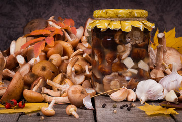 Fresh and preserving  in glass jar mushrooms with spices
