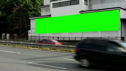 billboard on a building - green screen - street - cars