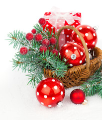 Christmas balls and fir branches with decorations isolated over