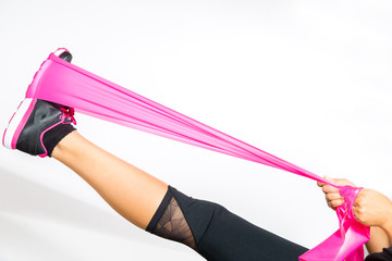 Woman stretches with resistance bands around her foot