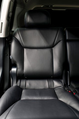 Rear passenger leather seat. Car interior.