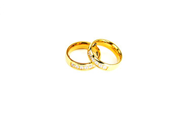 two gold ring on white background