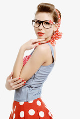 Pin-up young woman wearing glasses in vintage American style